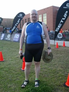 Me in my singlet, yes I still have a non-flattering mid section but its a work in progress.
