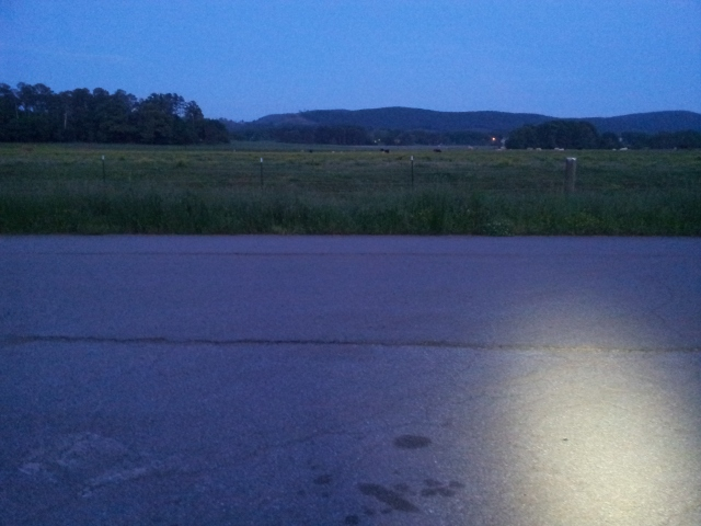 Getting dark, time to turn on the headlight.  I ride with allot of cows and pastures around.