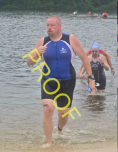 Coming out of the water, I already have my cap and goggles off and I am ready for the bike.