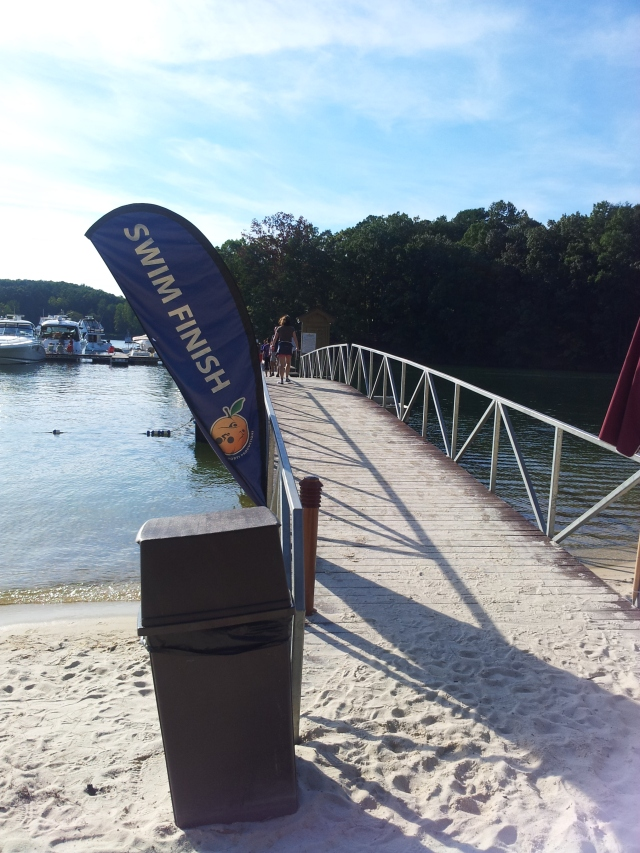 The end of the swim requires continuing down this dock to a steep uphill 3/10ths of a mile climb to transition.