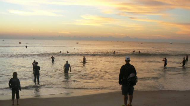 The sun coming up right before the start of the race.  My first ocean swim with waves, riptides and all  That's me in the blue top.