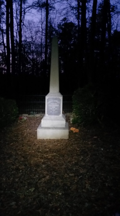Creepy funeral obelisk fenced off in the middle of the woods.  The strangest thing to run into while running in the dark.