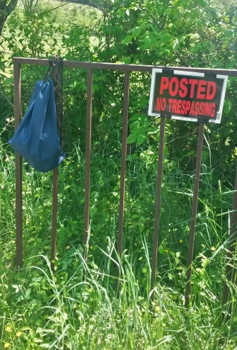 My drop bag hanging on the fence.  The idea was to resupply my gels and grab some nuts and food for my half way point.  I also resupplied sunscreen lotion and bodyglide.