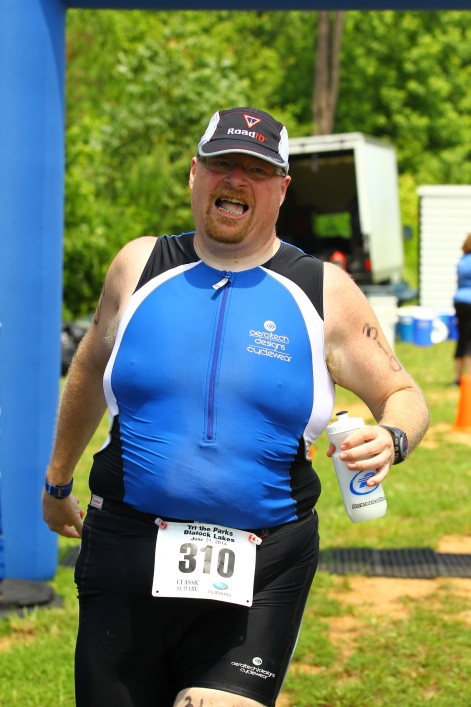 This picture says it all. As I crossed the final finish mat it was suddenly over and I just wanted shade and to rest my exhausted body.  Eventually I got my hands on a piece of cookie and a beer and went and cooled in the lake.